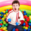 Happy birthday of little boy in balls. — Stock Photo
