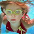 Child girl swim underwater in pool. — Stock Photo