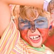 Girl with paint on face in kids club - Stock Photo