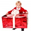 Happy boy with red gift box. — Stock Photo