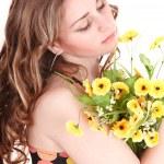 Beautiful girl with wild flower. — Stock Photo