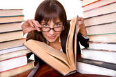 Clever girl with heap book. — Stock Photo