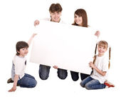 Happy family with white banner. — Stock Photo