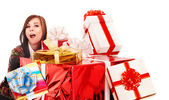 Beautiful girl with group of gift box. — Stock Photo