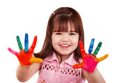 Happy child with colorful painted hands — Stock Photo