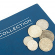 Royalty-Free Stock Photo: Old silver coins on an album