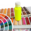 Bottle of paint on the color catalogs — Stockfoto