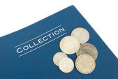 Old silver coins on an album — Stock Photo