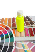 Bottle of paint on the color catalogs — Stock Photo