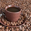 Coffee cup saucer and coffee beans - Stock Photo