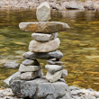 Stock Photo: Creekside Inukshuk