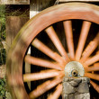 Stock Photo: Spinning grist mill water wheel