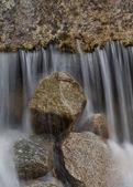 Waterfall falling on rocks — Stock Photo