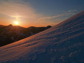 Sunset on a snowy alpine ridge — Stock Photo