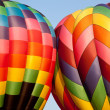 图库照片: Two Hot air balloons bumping