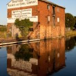 Royalty-Free Stock Photo: Shropshire warehouse reflected in canal