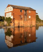 Red brick warehouse by Canal — Stock Photo