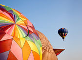 Hot air balloon in the air above two — Stock Photo