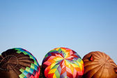 Three Hot air balloons being inflated — Stock Photo