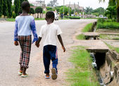 African boys on roadside — Stock Photo
