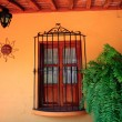 Orange wall with wooden window — Stock Photo