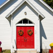 Close up of red church doors — Stock Photo