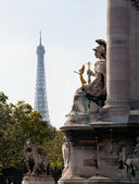 Eiffel tower framed by statue on Pont Al — Stock Photo