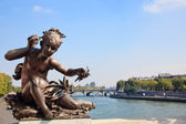Small child statue frames view of Seine — Stock Photo