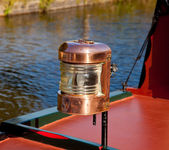 Ornate brass driving lamp on canal barge — Stock Photo
