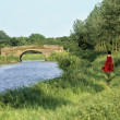 Stock Photo: Walking along canal bank