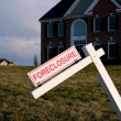 Modern house with foreclosure sign — Stock Photo
