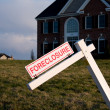 Modern house with foreclosure sign - Stock Photo