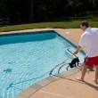 Man brushing pool — Stock Photo #1175495