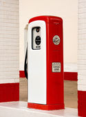 White and red ancient gas pump — Stock Photo