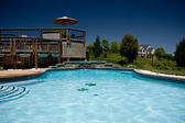 Water level view of pool and deck — Stock Photo