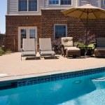 Backyard Pool with seats and umbrella — Stock Photo #1184486