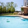 View of swimming pool and patio — Stok Fotoğraf #1184508