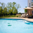 View of swimming pool and patio — Stock Photo #1184508