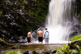 Boys in a waterfall — Stock Photo