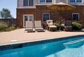 Backyard Pool with seats and umbrella — Stock Photo