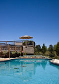 Swimming pool looking towards a deck — Stock Photo