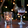 Glass of sherry with candle - Stock Photo