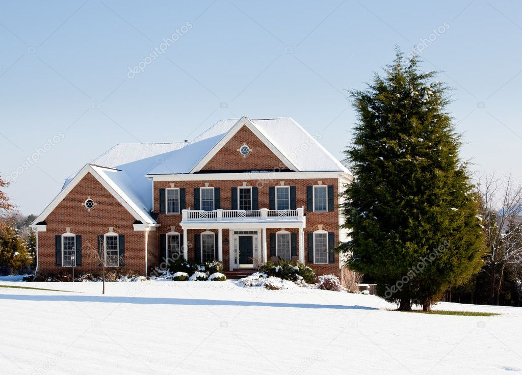 Modern home in a snowy setting with a conifer in the foreground — Stock Photo #1444959