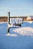 Mailbox deep in snow — Stock Photo