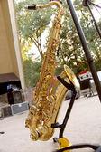 Saxophone standing on scene — Stock Photo