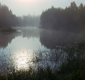 Fog on the silent river in the early mor — Stock Photo
