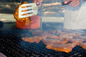 Preparation of a tuna on fire — Stock Photo