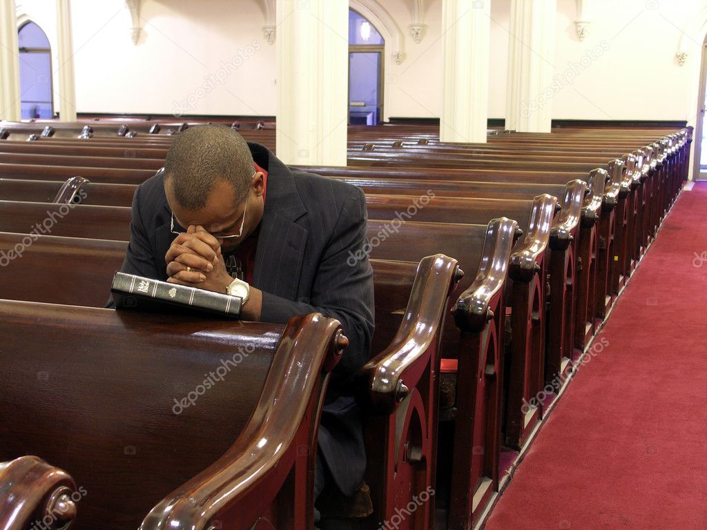 African-American man praying alone.  Photo #1019996