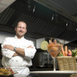 Smiling chef with fresh vegetables — Stock fotografie