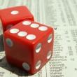 Постер, плакат: Red dice on stock report